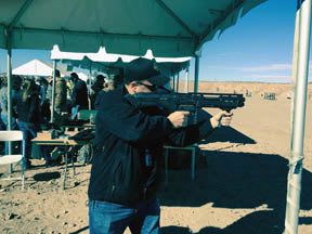 ACe Luciano shooting the DP-12 shotgun at an outdoor range in the desert