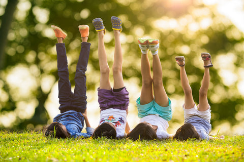 kids playing during a picnic in a park