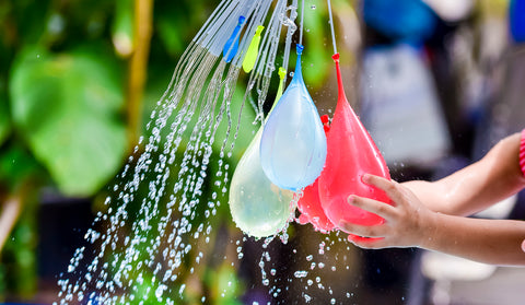 water balloon fight during picnic