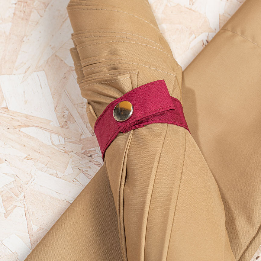 light brown umbrella with burgundy design detail