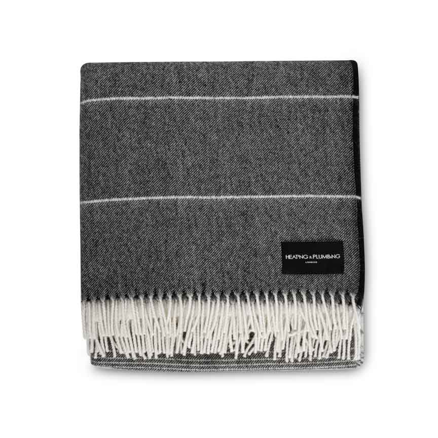 charcoal grey throw in alpaca with soft white fringe