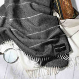 home throw in alpaca with black fringe