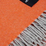 soft orange throw with grey fringe