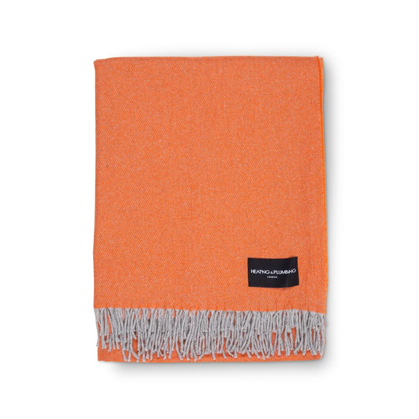 large bedroom cashmere throw in orange and grey