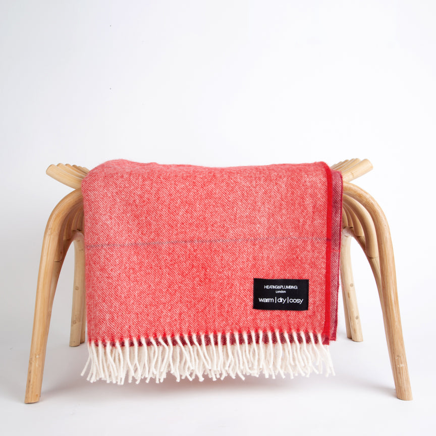 red throw in alpaca with white fringe