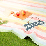 Soft outdoor blanket in multi-coloured stripes