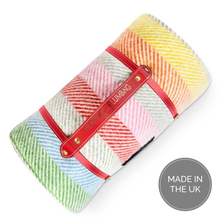 Rainbow coloured striped wool picnic blanket