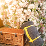 coffee brown and black picnic blanket with yellow leather strap