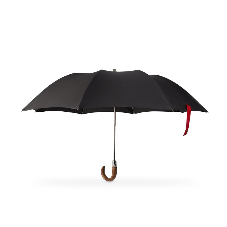 small folding British made umbrella with wooden handle