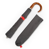 grey and red English umbrella with wood handle