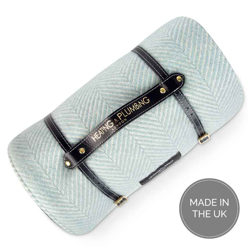 Navy blue leather strap with duck egg blue picnic rug