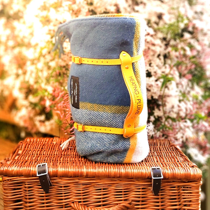 Blue and yellow picnic blanket with yellow leather strap