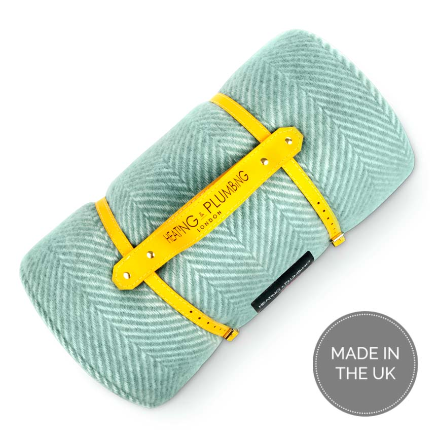 Mint green picnic throw with yellow waterproof backing and yellow leather carrying strap in pure new wool