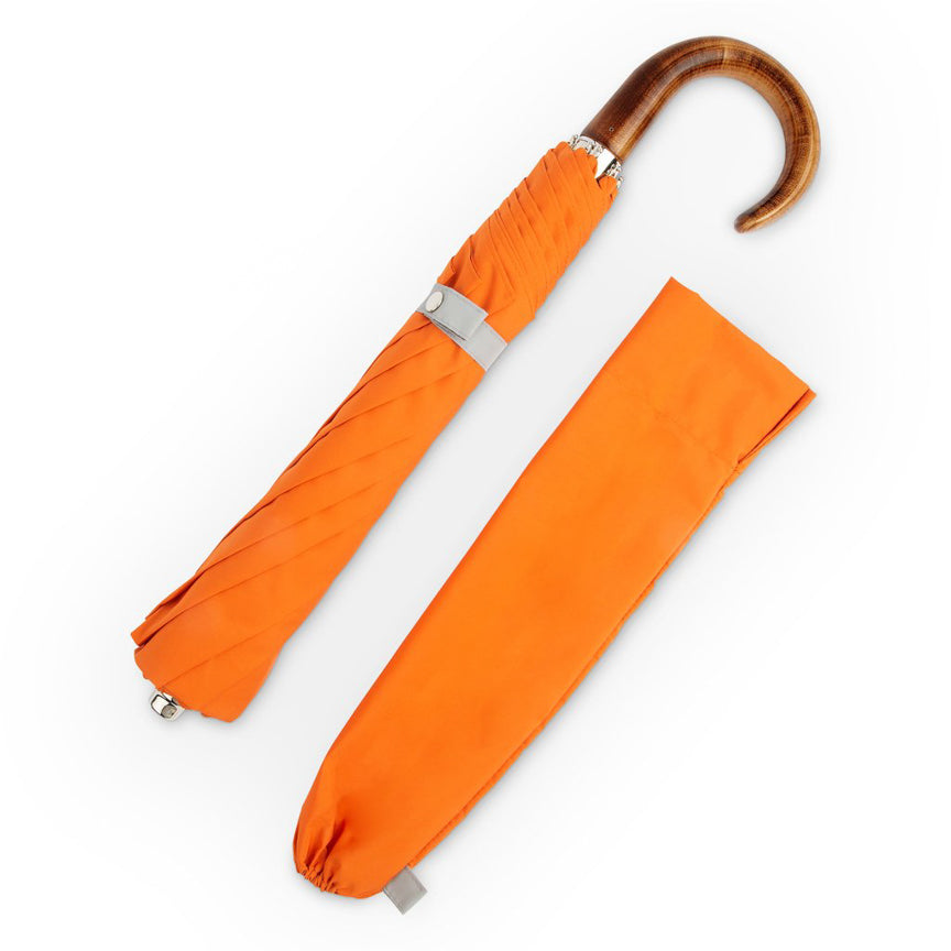 orange folding umbrella with wood handle
