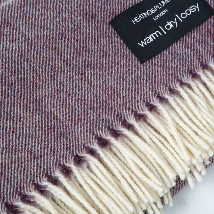 purple home throw with white fringe