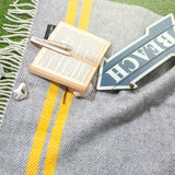 grey and yellow picnic blanket with waterproof backing