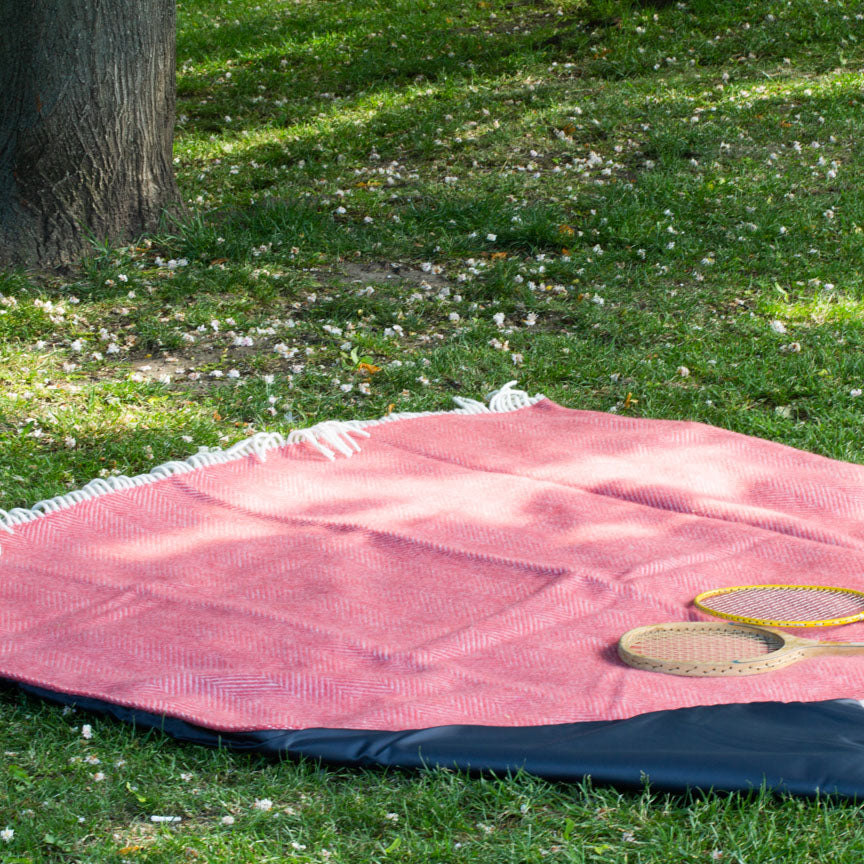 cranberry red picnic blanket with grey waterproof backing