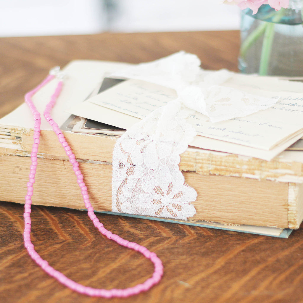 Hot Pink Seed Bead Bracelet  Wrap or Necklace on vintage books