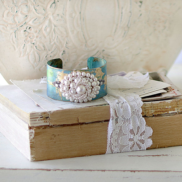 Boho Bracelet Cuff close up on vintage book stack
