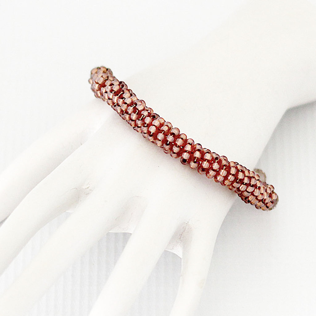 Rose Gold Seed Bead Bracelet on hand mannequin