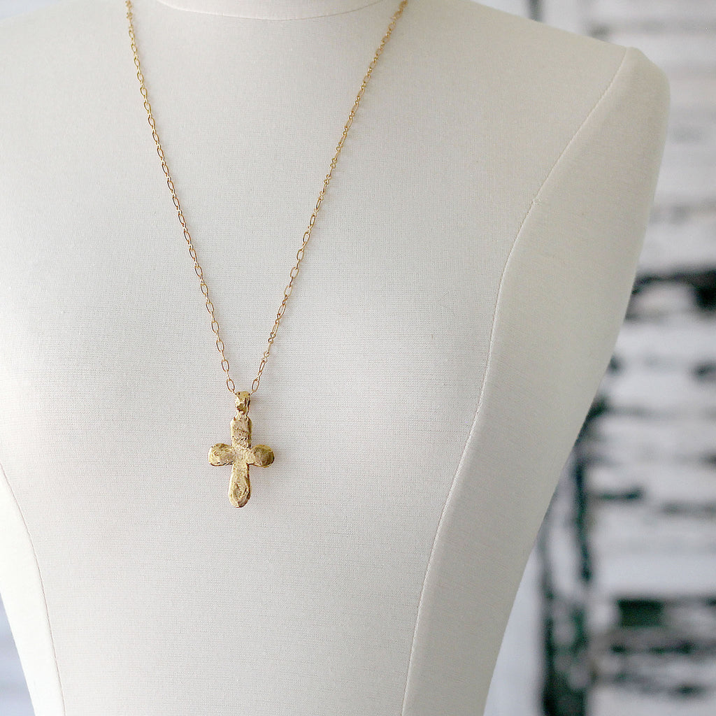 Gold Hammered Cross Pendant Necklace on mannequin