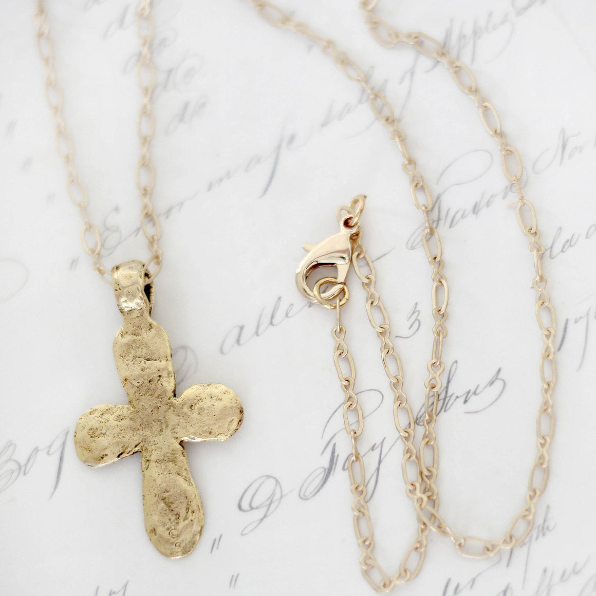 Gold Hammered Cross Pendant Necklace close up