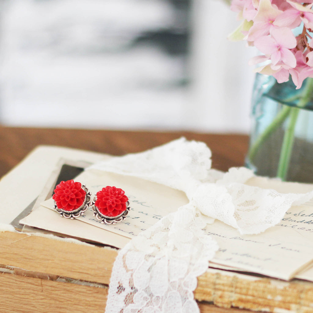 Dahlia Post Earrings Sassy Red on book