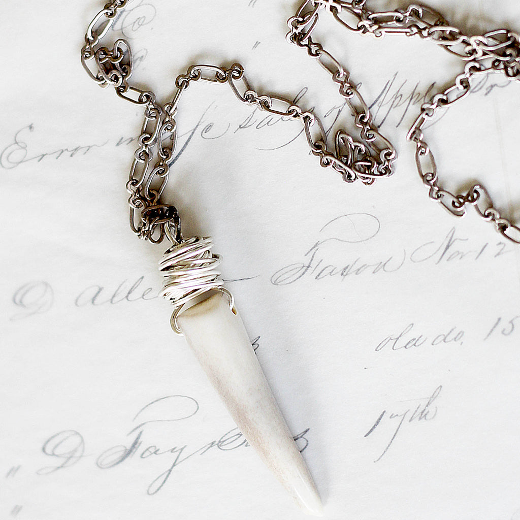 Gray Deer Antler Necklace on vintage ledger paper