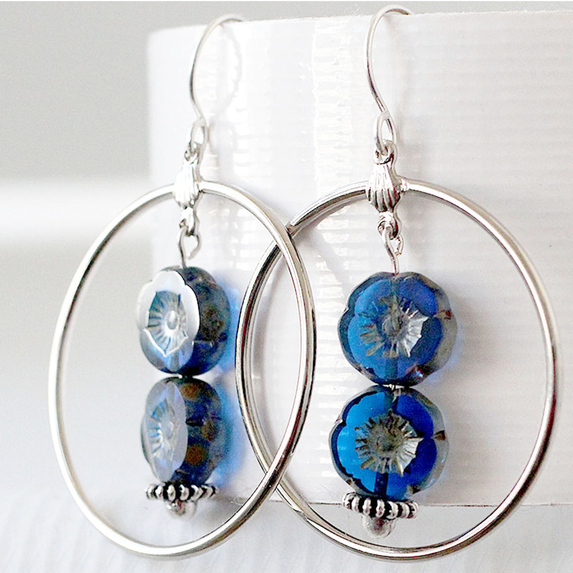 Large Hoop Earrings Silver with Cobalt Blue Flower Beads close up