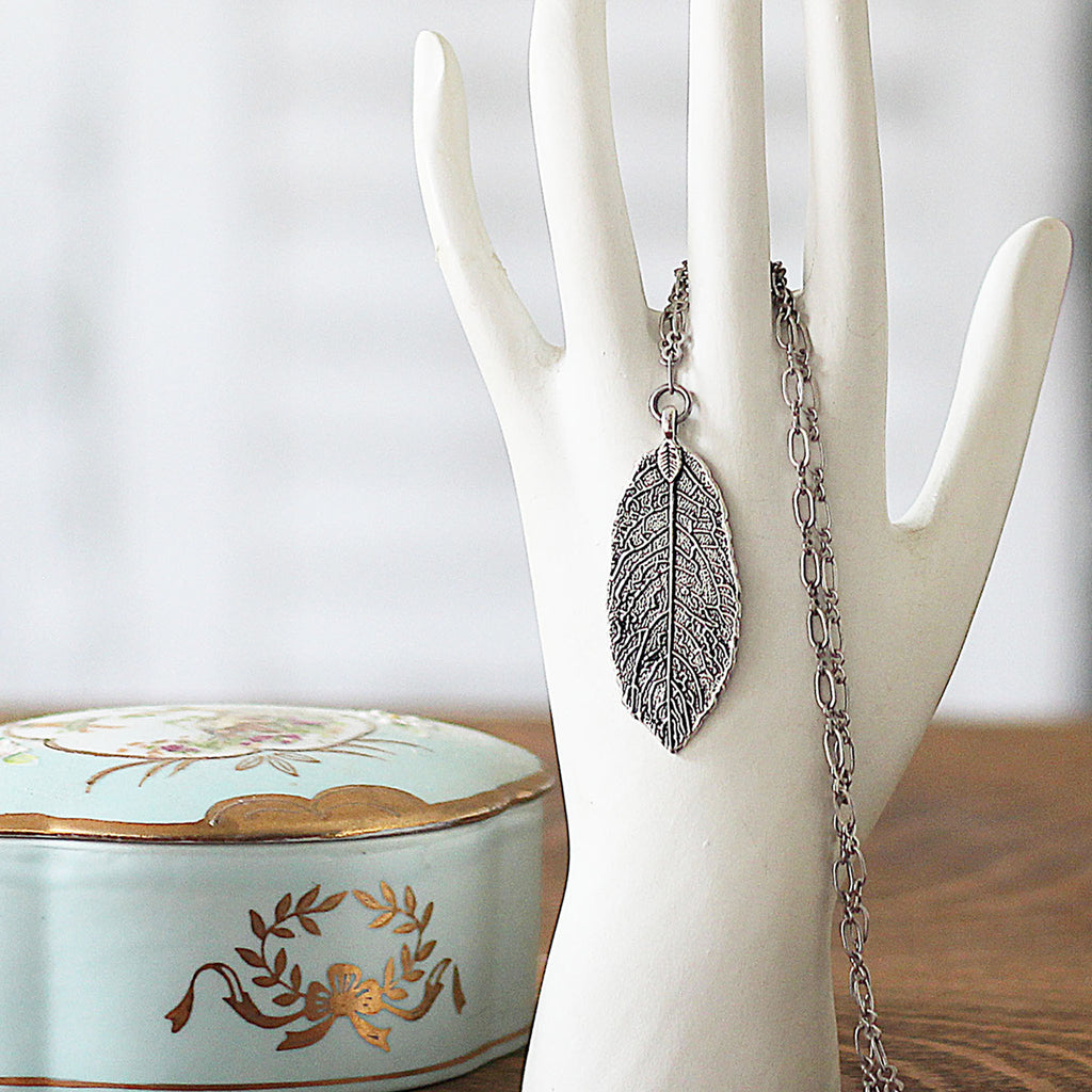 Textured Silver Leaf Pendant Jewelry on hand mannequin