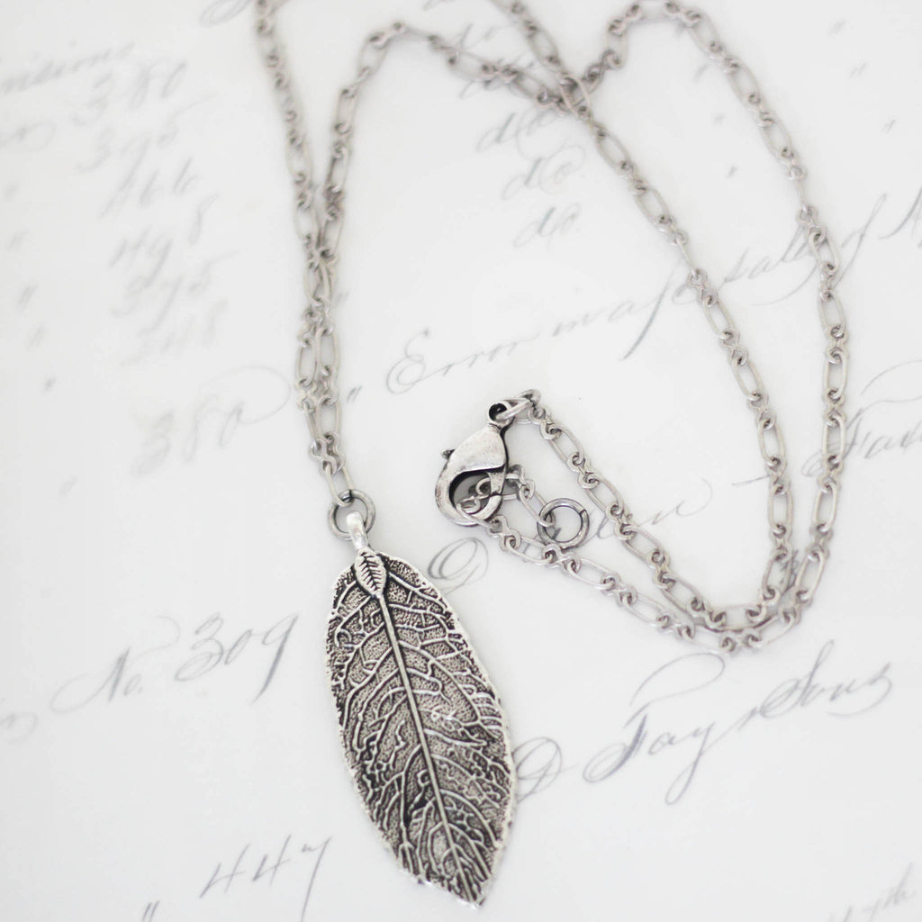 Textured Silver Leaf Pendant Jewelry close up