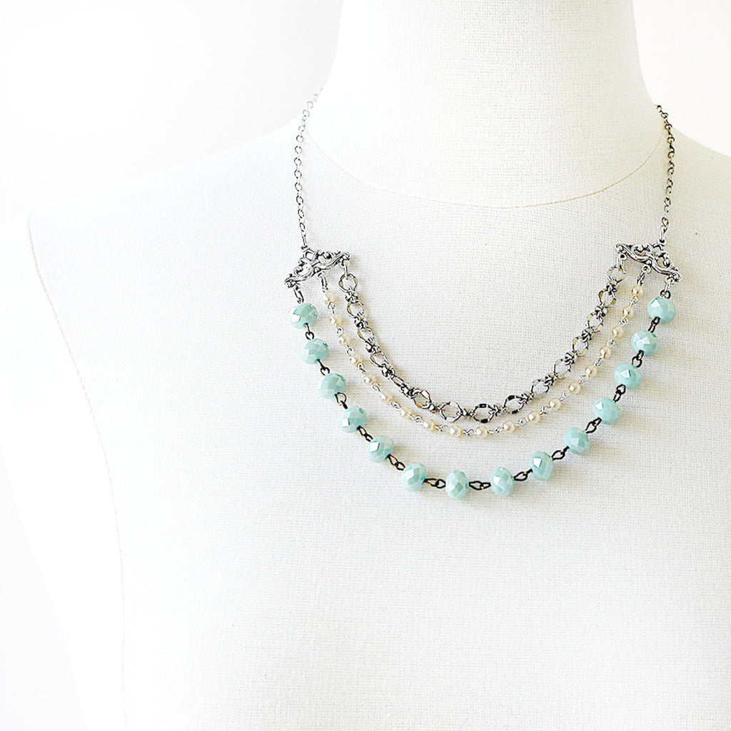 mannequin wearing silver and seafoam Beaded Multi Strand Necklace