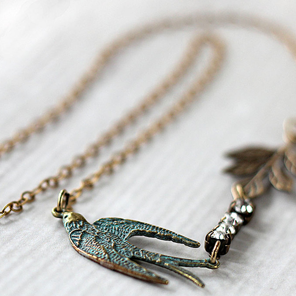 Flying Swallow Bird Necklace Patina Blue and Gold Toned Brass close up
