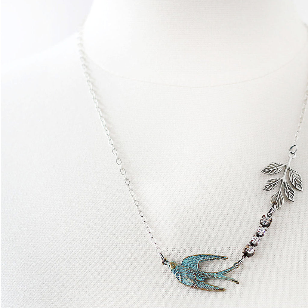 Flying Swallow Bird Necklace - Patina Blue and Silver mannequin front