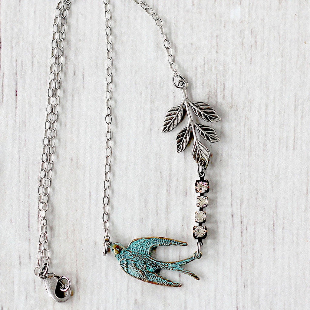 Flying Swallow Bird Necklace - Patina Blue and Silver close up of bird and chain
