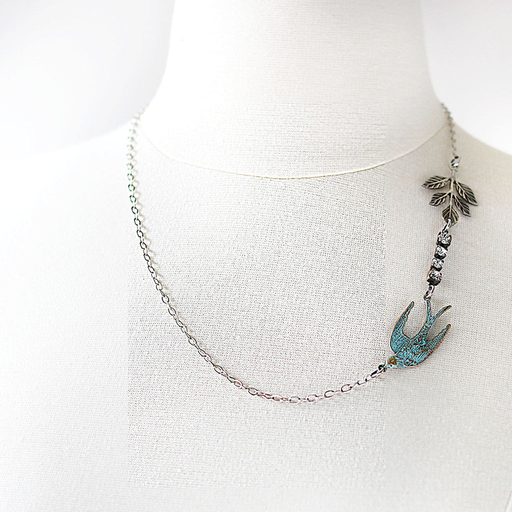 Flying Swallow Bird Necklace - Patina Blue and Silver worn asymetrically