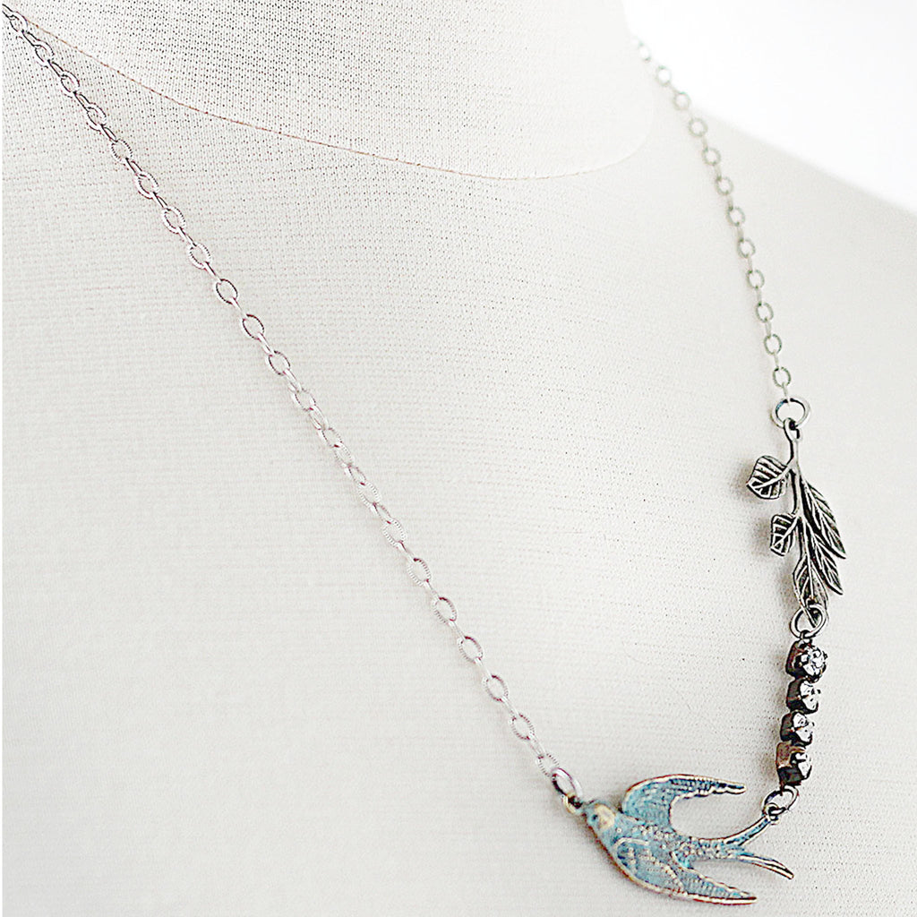 Flying Swallow Bird Necklace - Patina Blue and Silver facing right