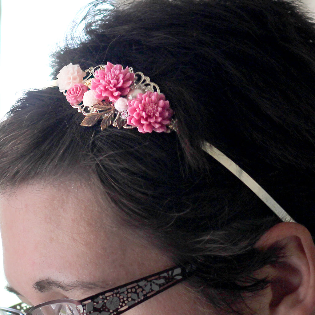 Pink Flower Headband up close in models hair