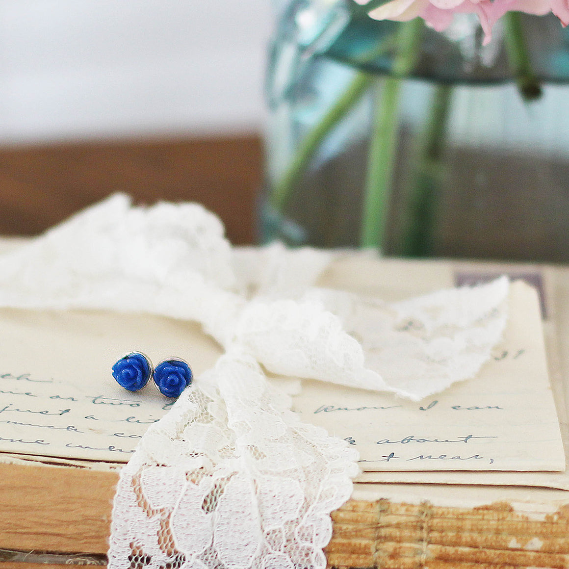 Post Rose Earrings Deep Blue on lace tied vintage books