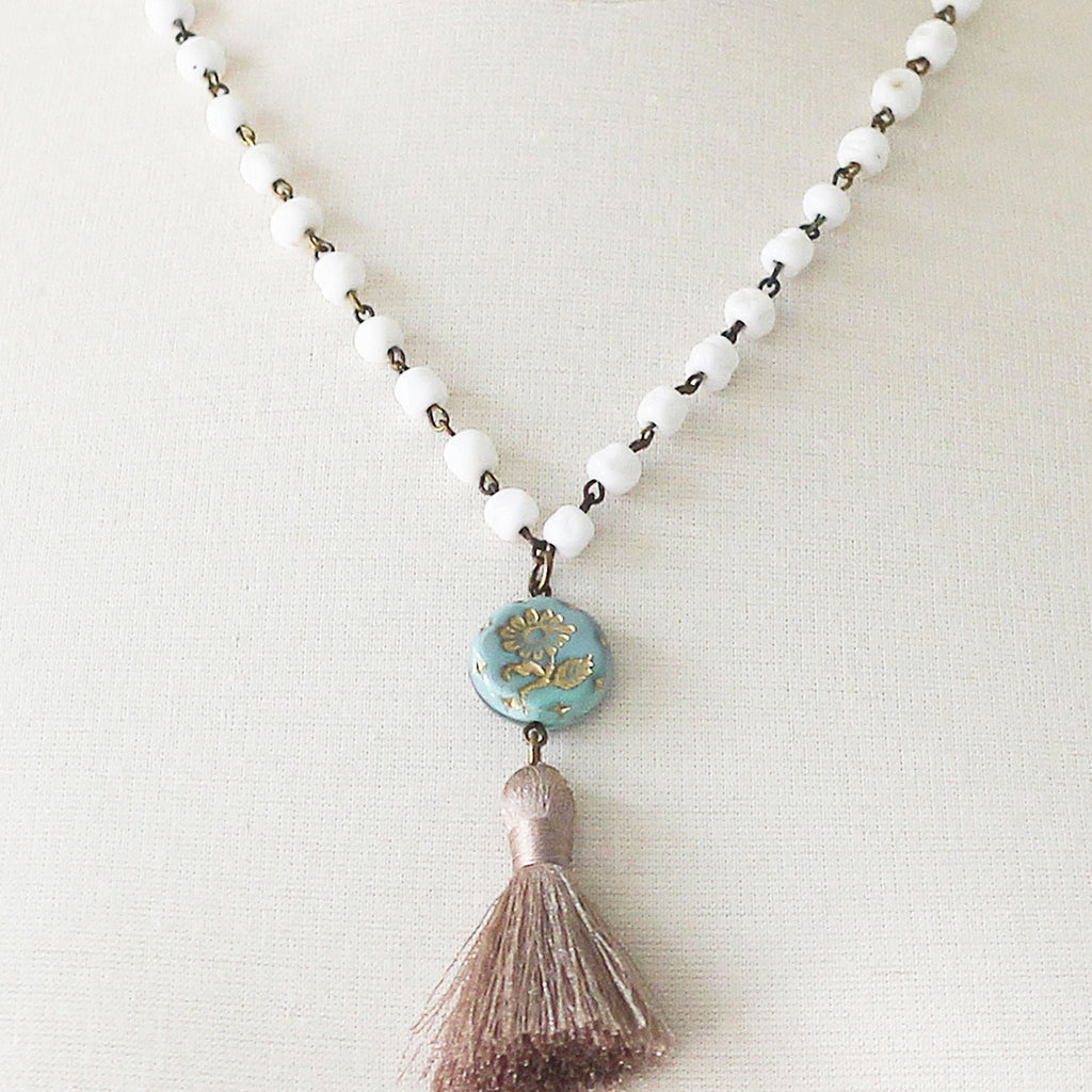 Milk Glass Beaded Tassel Necklace close up on mannequin