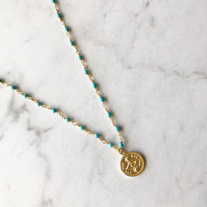 Gold Evil Eye Charm on Turquoise Rosary Chain Necklace