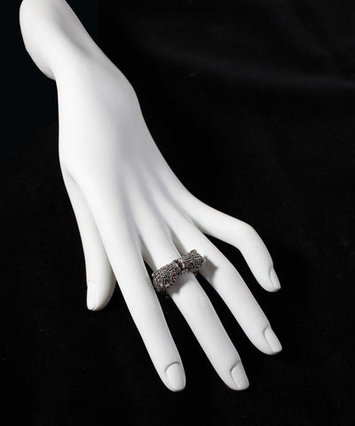 LESSisRARE Panthère art deco ring silver, marcasite and ruby