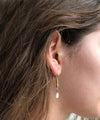"Eloise fiorentino hammered earrings, fine gold gilding and mother-of-pearl pearls - ""Cocoon"" worn"