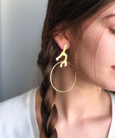 Creole earrings roots designer Eloise Fiorentino worn