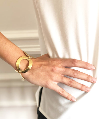 Carole saint germes golden metal ring bracelet worn
