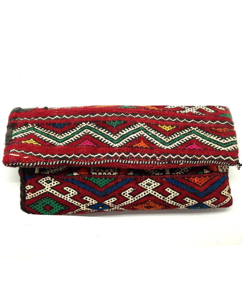 el-jenna-pouch-kilim-wave worn Editions LESSisRARE