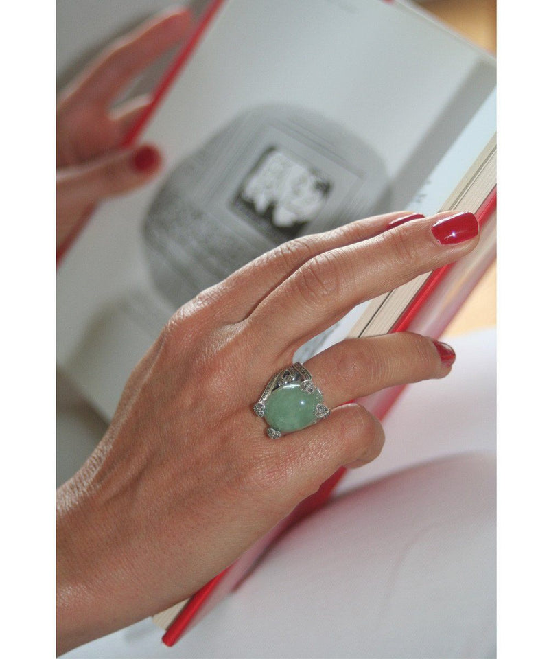 Art deco jade ring adorned with silver and designer marcasites