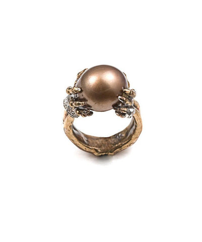 Pearl ring in the hands of a skeleton in gold and diamonds 2
