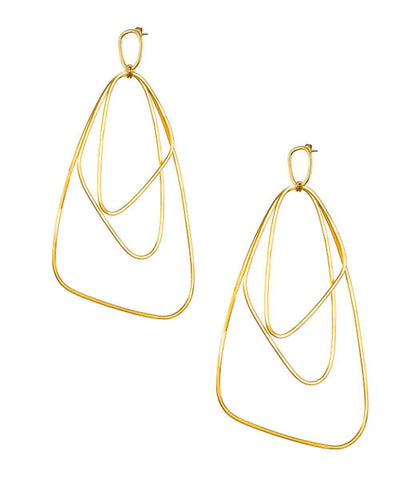 "Giant golden earrings - ""Here"" designer Eloise Fiorentino"
