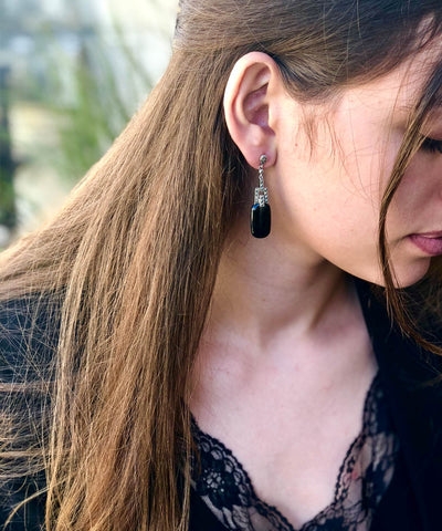Onyx and marcasite pendant earrings worn